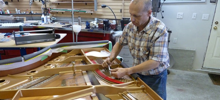Piano soundboard repairs and restringing